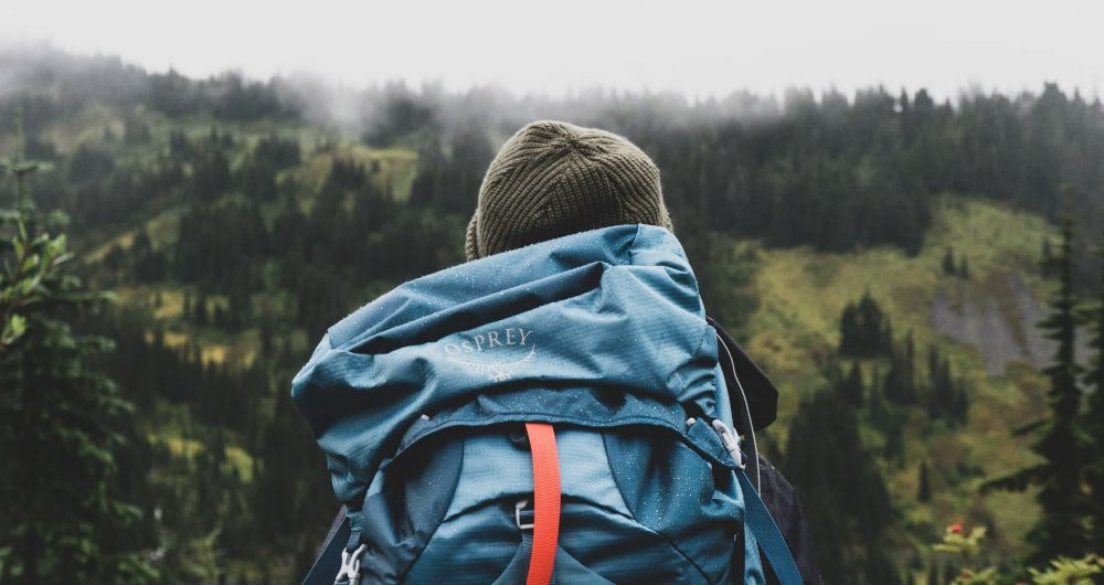 backpackingwomanwithmountainsandbeanie